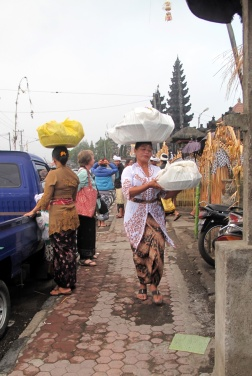 Women with gifts for ceremony