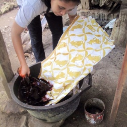 Mufidah dyeing her batik in natural dye from Mahogany bark.