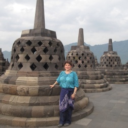 By the stupas at the top of Borobudur.