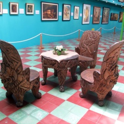 Tabl and chairs carved out of solid Balinese Mahogany, by Nyoman Tjokot .