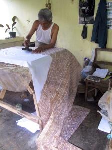 The Perang motif being printed on to metres of cotton.