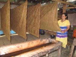 Mrs Siti with her drying batiks in Giriloyo .