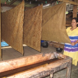 Mrs Siti with her drying batiks in Giriloyo .