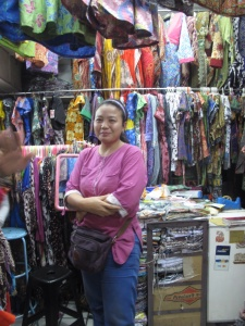 """Market stall in the """"more middle class """" market , selling batik shirts and dresses."""