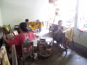 Women working on different stages of the batik.