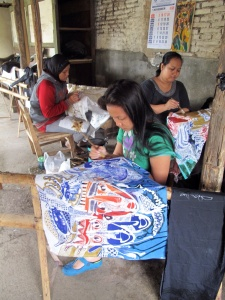 Three ladies working on Bambang's batiks.