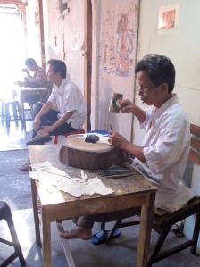 Tatang and his friends in the workshop.