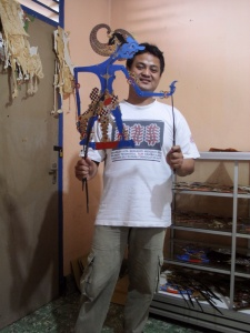 The Dalang, or puppeteer demonstrating how the puppet moves.