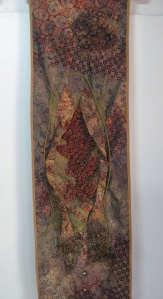 Three dimensional piece, sculpted batik and stitch.