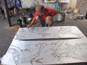 Aprat working on a silk batik with paraffin wax, for crackle and beeswax for linear definition.