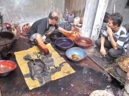 Koeswadji Aprat dying a batik with Napthol. Dye.