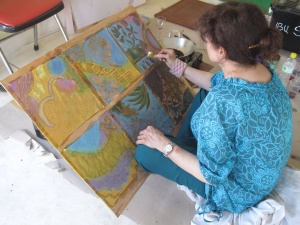 Batiking the Javanese  way, Marina Elphick UK batik artist working on contemporary batik sketches for planned batik art works.