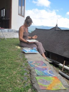 Cristiana sketching while my work dries in the sun