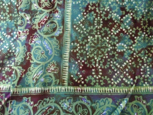 Cap batik bought from batik factory in Yogyakarta .