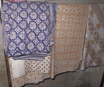 Nitik batiks at various stages of the process at Mrs Aminah's and Mrs Yati's home in Kembang Songo village.