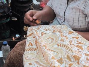 Close up view of woman's canting work, Danar Hadi batik factory