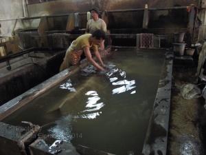 The huge rinsing baths at Danar Hadi Batik factory
