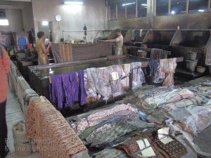 Dye room with workers rinsing the completed batik