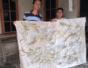 Tatang and Mrs Arminah with their collaborative batik in progress