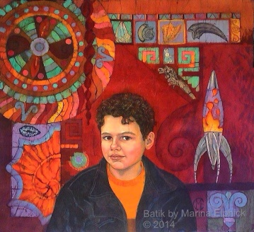 Batik art portrait of Edmund with solar Disc and Lava lamp. Portrait by contemporary batik artist Marina Elphick. Children's portraits her speciality.