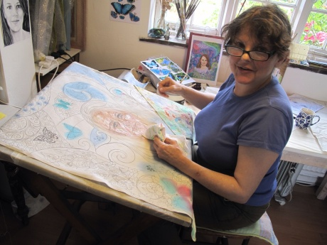 Marina Elphick making a batik portrait in her Sussex studio, UK.