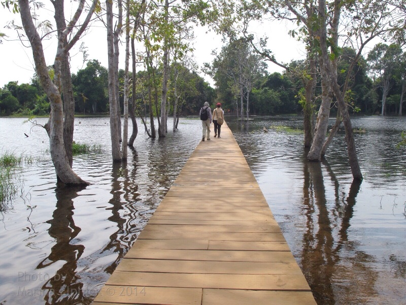 Walk way across Neak Pean's outer lake.