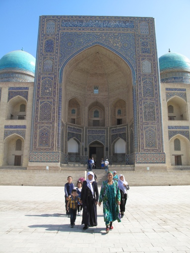 Women in front of Miri-Arab Madrasah, Bukhara, Uzbekistan.