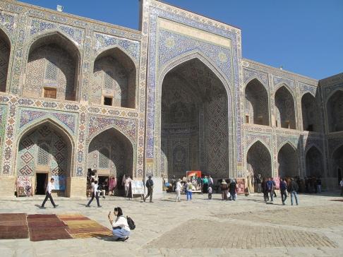 Sher-Dor Madrasah, inner courtyard with vendors, Samarkand, Uzbekistan.