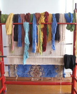 Silk woven carpet, coloured using natural dyes.