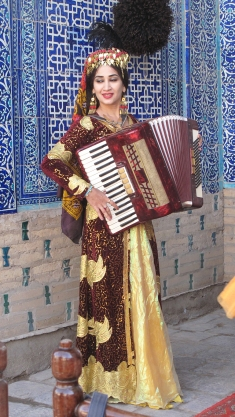 Song and Dance in Harem, Khiva, accordion player. Uzbekistan.