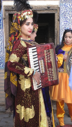 Song and Dance in Harem, Khiva, accordion player and dancer, Uzbekistan.