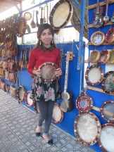 Tambourine seller Bukhara, Richard bought one of these. Uzbekistan.