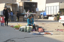 Locals selling their produce at market, Khiva. Uzbekistan.