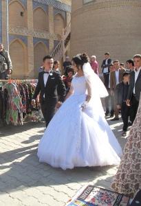 A modern wedding, couple at Islam-Khadja Madrasah, Khiva, Uzbekistan.
