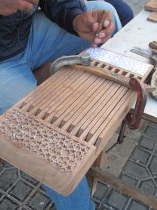 Woodcarver, detail, Bukhara. Uzbekistan.