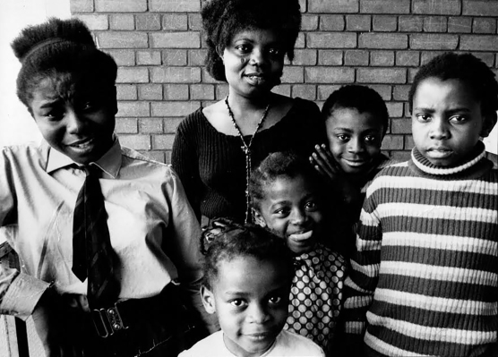 Buchi Emecheta and her children. Photo used courtesy of the Onwordi family.
